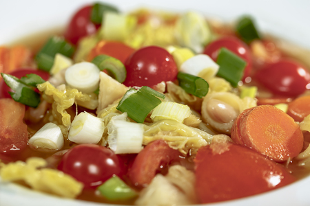 nahaufnahme: Minestrone with Savoy cabbage, carrots, white beans, and tomatoes Cobbettis Stock Photo