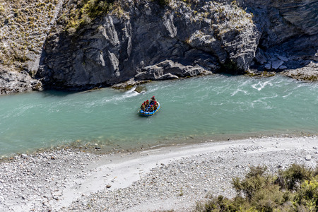 New Zealand South Island - White water rafting on the Shotover River on Skippers Canyon Road north of Queenstown in the Otago region Standard-Bild - 127443761