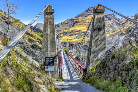 New Zealand South Iceland - Skippers suspension bridge over the Shotover River on Skippers Canyon Road north of Queenstown in the Otago region Standard-Bild - 127443908