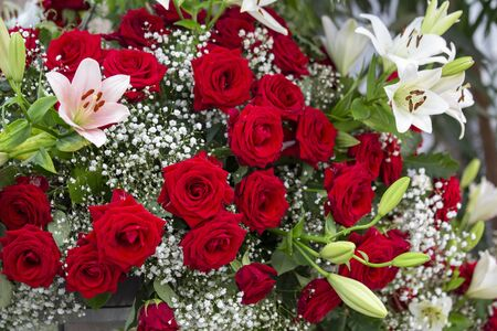Bouquet with red roses and lilies with gypsophila Standard-Bild - 127443923