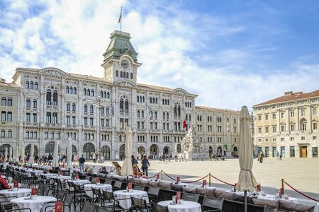Historic coffee house with the town hall and fountain of the four continents in Trieste Standard-Bild - 127444181