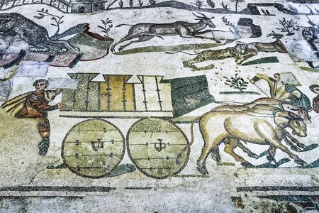 PIAZZA ARMERINA, SICILY, ITALY - May 24, 2018: Ancient Roman mosaics in the archaeological site of Villa Romana del Casale - UNESCO World Heritage Site