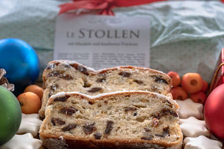 Close-up of two slices of Christmas stollen with almonds and candied fruit