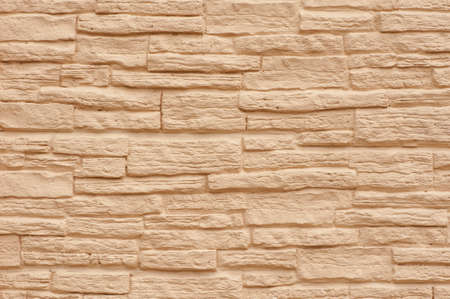 Close up stone wall. Beige stone wall, stone texture.