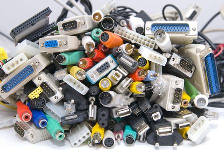 lots of various connectors from various appliances and devices photo