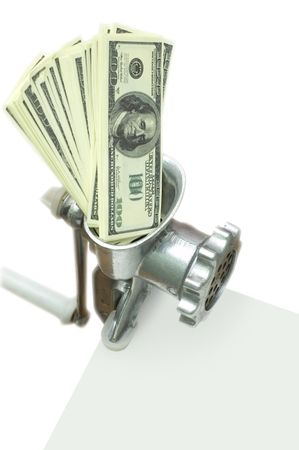 batch of false 100 dollar bills in metal hand held meat chopper against white background photo