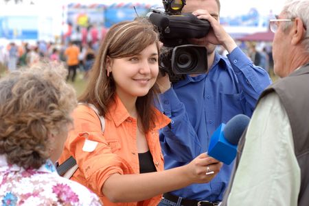 young woman journalist is interviewing on Baikal Day on August 3, 2008 at Baikal Lake, Buryatia, Russia Stock Photo