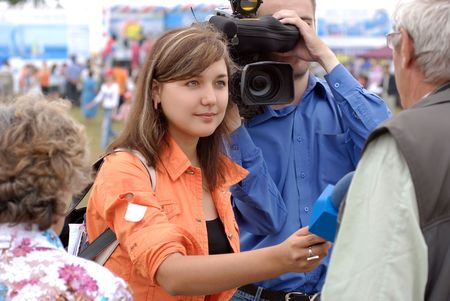 baikal: female reporter is interviewing on Baikal Day on August 3, 2008 at Baikal Lake, Buryatia, Russia Stock Photo