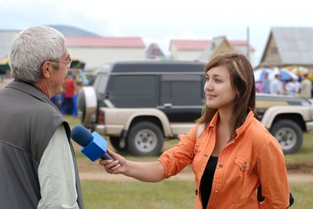 female reporter is interviewing on Baikal Day on August 3, 2008 at Baikal Lake, Buryatia, Russia Stock Photo