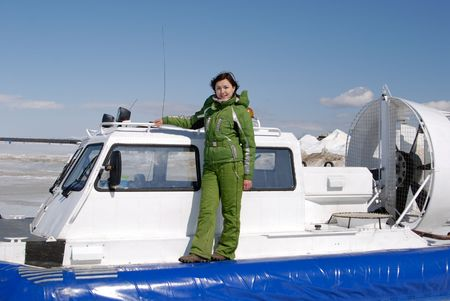 hovercraft: young girl and hovercraft at winter Baikal