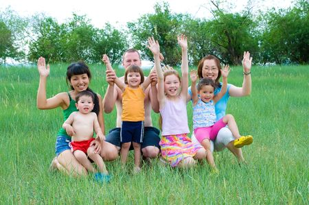 happy adults and children smiling waving hands photo