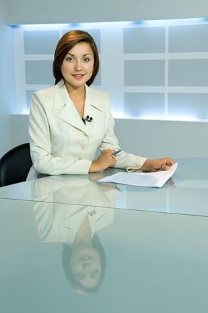 smiling television anchorwoman at studio  during work