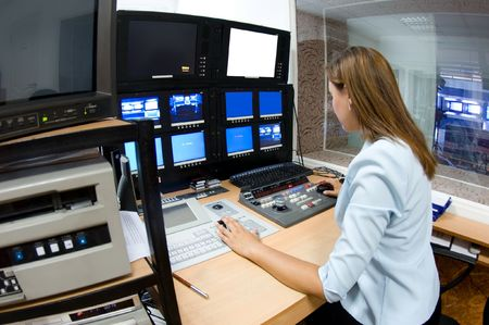 female TV director at editor in studio Stock Photo - 5284274