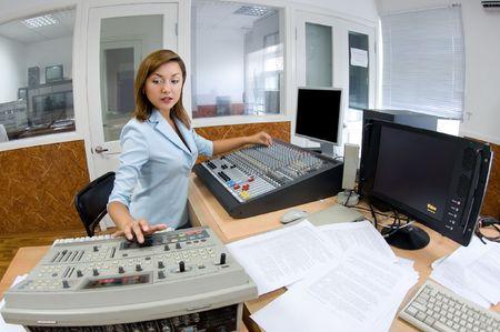 editor: female TV director at editor in studio