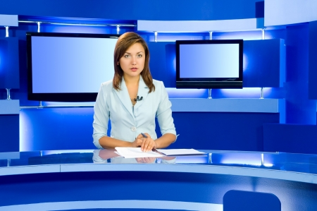 newsreader: television anchorwoman at studio during live broadcasting Stock Photo