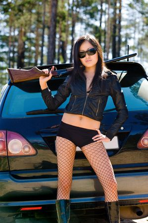 sexy asian girl with gun by car photo