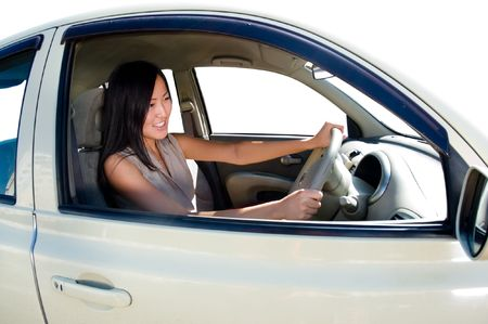 pretty young asian girl driving a car Stock Photo
