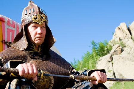 european man in ancient Mongolian soldier armour