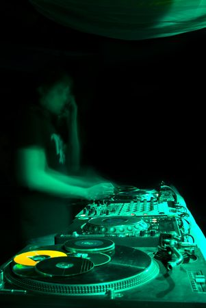 electro: blurred dj at spin table in night club Stock Photo