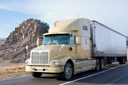 big refrigerator truck moves on a road