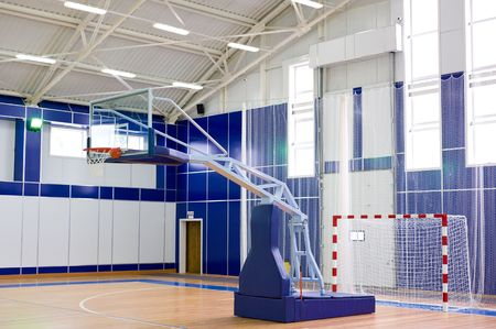part of sports gym with modern basketball upright and soccer goal photo
