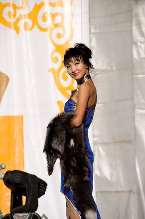 mongolian: ULAN-UDE, RUSSIA - SEPTEMBER 5: An asian female model demonstrates a dress in ethnic (buryat, close to mongolian) style at the fashion show on The City Day celebration September 5, 2009 in Ulan-Ude, Buryatia, Russia. Editorial