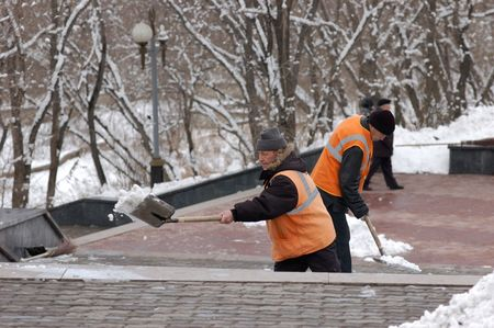 ULAN-UDE, RUSSIA - MARCH 28: Municipal street cleaners remove snow with shovels on March 28, 2009 in Ulan-Ude, Buryatia, Russia. Stock Photo - 6887369
