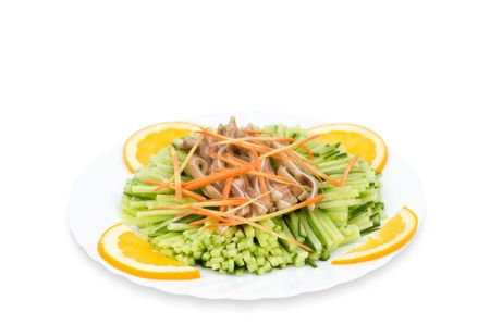 Chinese food. Shredded cucumbers, meat and carrots decorated with oranges. photo