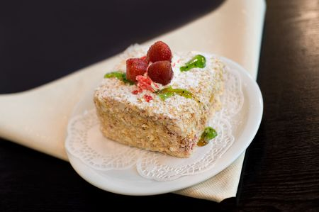 bestrew: napoleon cake with three strawberries on top and green jelly Stock Photo