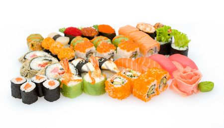 sushi plate: lots of various Japanese sushi and sushi rolls Stock Photo
