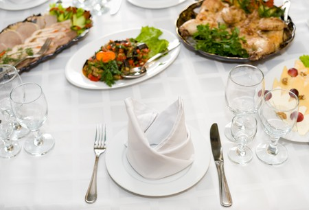 served dinner for one person at laid restaurant banquet table photo