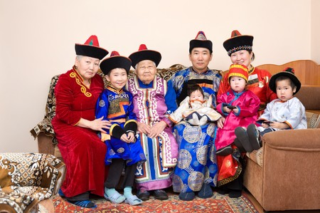 descendants: big buryat (mongolian) family: great grandmother, grandmother, son with wife and their children, in national costumes Stock Photo