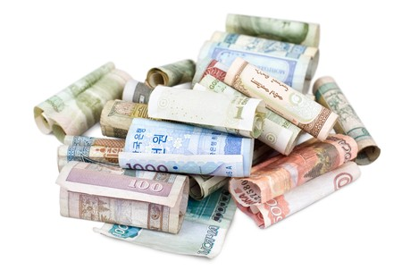 arabic currency: some rolled bank papers of different countries