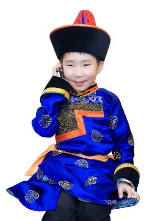 8 year old Buryat (Mongolian) boy speaks over mobile phone photo