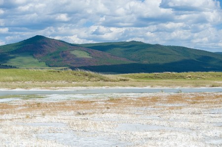 brine: a brine lake and mountains in the background Stock Photo