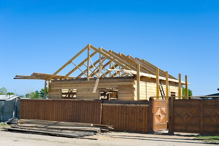 roof beam: a wooden country house under construction