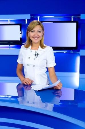 a television anchorwoman at studio, looks into camera Stock Photo - 7365431