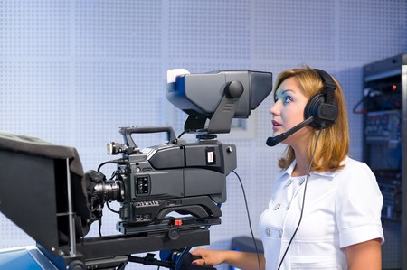 a female cameraman at a studio during live broadcasting Stock Photo - 7376332