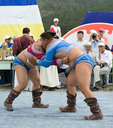 naadan: ULAN-UDE, RUSSIA - JULY 17: The 4th General Session of the World Mongolians Convention, July 17, 2010 in Ulan-Ude, Buryatia, Russia. Mongolian national wrestling in heavy weight.