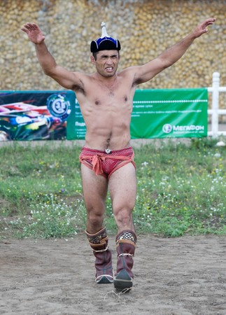 naadan: ULAN-UDE, RUSSIA - JULY 17: The 4th General Session of the World Mongolians Convention, July 17, 2010 in Ulan-Ude, Buryatia, Russia. Wrestler winner performs a victory dance. Editorial