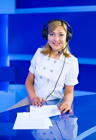 a young caucasian woman operator at a blue call center Stock Photo - 7451050