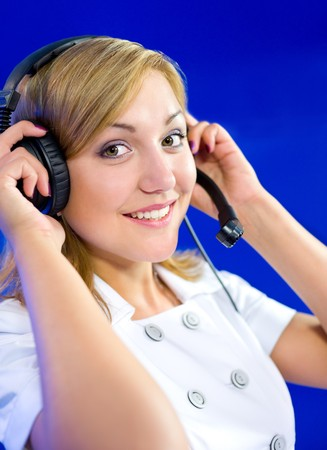 a young caucasian woman operator at a blue call center photo