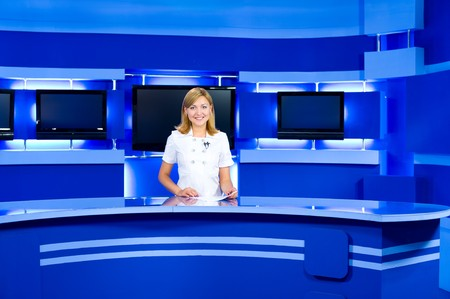 a television anchorwoman at studio during live broadcasting Stock Photo