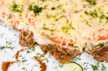 well done beefsteak with tomatoes and cheese, macro photo