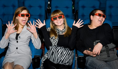 viewers with 3D glasses - three emotional young women Stock Photo - 7908058