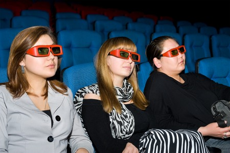 viewers with 3D glasses - three young women photo