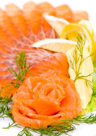sliced smoked salmon served with lemon and salmon rose