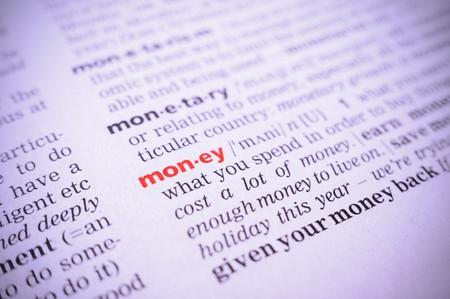 glossary: the word money in a glossary, macro, violet toning Stock Photo