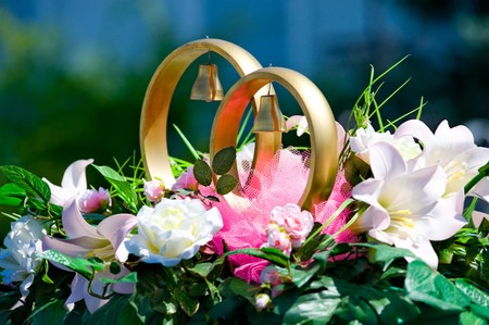 golden rings and flowers as wed car decoration photo