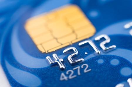 a blue bank card, macro, narrow focus photo